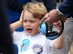 Prince George of Cambridge, scared by the fly past of Red Arrow jets, is at the Royal International Air Tattoo in Gloucestershire. July 8 2016