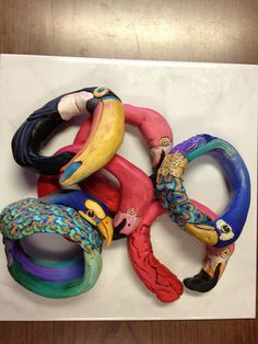 Bracelets shaped like birds. Toucan, flamingo, peacock, all made from polymer clay by Alice Stroppel.Birds birds birds by AliceStroppel, via Flickr