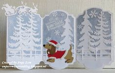 handmade winter/Christmas card from Anja Zom map Blog ... triptych ... light blue background with white die cut trees and Santa in sleigh with deer  .. .. luv the colorful focal image ... dachshund in Santa Suit ...