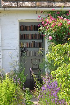Virginia Woolf's bedroom - a little paradise: books and flowers.