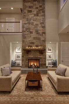 The color palate for the couches and area rug against the stone fireplace and light floors Cozy Fireplace, Living Room With Fireplace, Home Living Room, Living Room Designs, Fireplace Ideas, Fireplace Seating, Modern Fireplace, Living Spaces, Candle Fireplace
