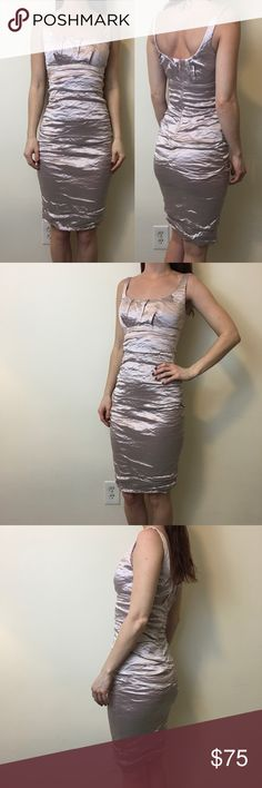 """Nicole Miller Frosty Pink Pleated Bodycon Dress Gorgeous and a stunner- pink frosty dress with a sleeveless top and has a Pleated style outside. Textured and is lined- zipper closure and is super stretchy. Is a size 0 but fits a 2. Flat measurements are bust 14.5"""" waist 10.5"""" hips 14""""+ and 38"""" length Nicole by Nicole Miller Dresses Midi"""