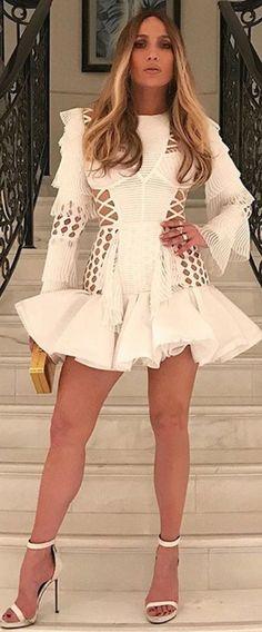 d6f95b259d58 Who made Jennifer Lopez s white cut out ruffle dress