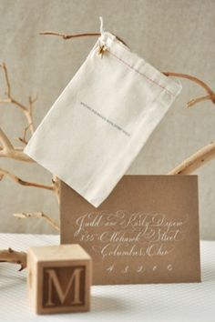 Gray and gold announcements from Oscar + Emma. Like the gold envelopes + white ink.