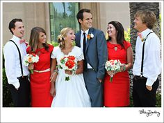 I love everything about this: bridesmaids dressed, wedding dress, flowers, groomsmen, everything!