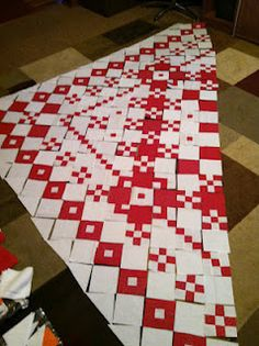Love this red and white quilt layout!