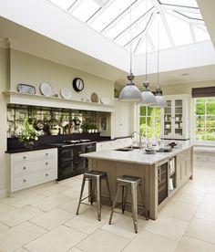 Bespoke Martin Moore kitchen with antiqued mirror glass splashback martinmoore.com