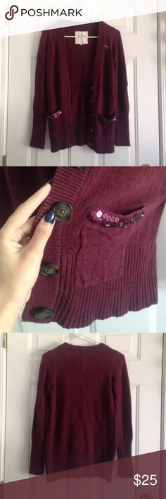 Abercrombie & Fitch Button-Up Cardigan A gently used maroon button-up cardigan. It has two sequined pockets, and big buttons that say Abercrombie on them. This cardigan is in perfect condition with no damages, missing sequins, or tears. Abercrombie & Fitch Sweaters Cardigans
