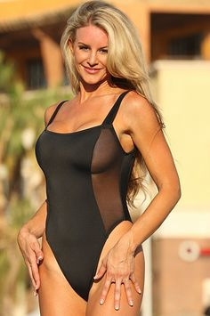 Not your basic black bathing suit! This sexy designer one piece features a sheer panel running down each side for a provacative peek. This will turn heads at the beach, club or cruise vacation.      Square neckline     Thicker supportive straps      Scooped Back     High cut legs     Partially Lined