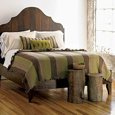Love this headboard. DIY pallet opportunity here with an eco-friendly dark stain. #upcycle