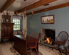 Colonial dining with fireplace