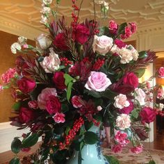 Just in time for Christmas this beautiful arrangement featuring: winterberry, leucadendron, roses, spraycarnations