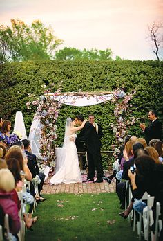 Brides: Cherry Blossom Ceremony Chuppah. At an outdoor garden ceremony in the spring, the florist can decorate the chuppah or altar area with cherry blossom branches.