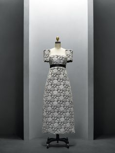 House of Chanel (French, founded 1913), Karl Lagerfeld (French, born Hamburg, 1938). Dress, spring/summer 2013, Haute Couture. Machine–sewn black synthetic scuba knit bonded with white cotton lace, black stretch satin; hand–finished. Photo © Nicholas Alan Cope. #ManusxMachina #CostumeInstitute