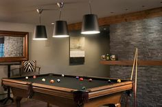 Pinney Designs - basements - games room, pool room, pool table, man cave, stacked stone wall, stacked stone accent wall, drinks ledge, walnu...