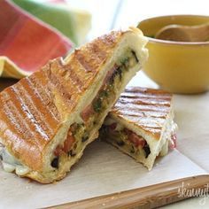 A perfect summer panini made with eggplant, tomatoes, mozzarella and skinny pesto on crispy French bread. Make this for one, or for the whole family.