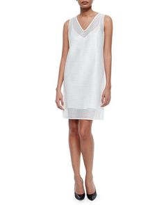This geometric/eyelet shift dress is on sale. Great for an engagement party or bridal shower!