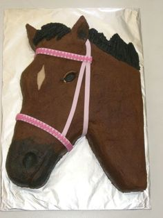 Horse This is for a little 6 year old girl! It is buttercream, with a fondant bridle. It took me a lot longer to do the pattern on the...