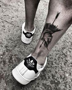 Calf tattoo helmet and spear, calf helmet spear Tattoo Armband Tattoos, Leg Tattoos, Body Art Tattoos, Sleeve Tattoos, Maori Tattoos, Calve Tattoo, Calf Tattoo Men, Black Tattoo Art, Black Tattoos