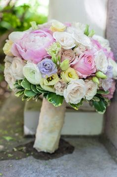 Pretty Bridal Florals Comprised Of: Pink Peonies, Lavender Roses, Cream Sahara Roses, Pink Roses, White Roses, Yellow Lisianthus, White Ranunculus, & Green Bush Ivy