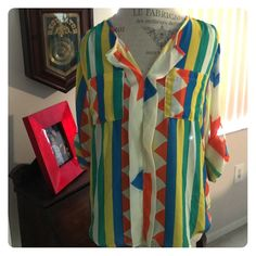 BLOUSE 🌼 Bursting with Color is a Multicolor striped blouse with roll-up sleeves with button tab Front Pockets 100%polyester Sad to say😂this is a re-Posh NWOT.....my loss is your gain; it's adorable No Trades No PayPal Tops Blouses