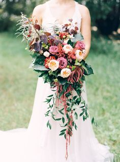 burgundy wedding bouquets, photo by Milton Photography http://ruffledblog.com/blooming-wedding-inspiration #weddingbouquet #marsala #flowers