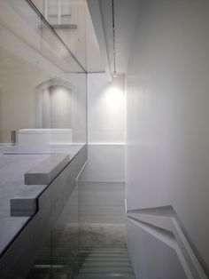 Luisa Via Roma / Claudio Nardi Architects. Interesting shaped rail.