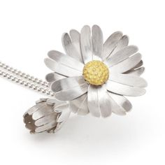 A locket that opens and closes into a daisy! Clever!
