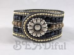Taking Chan Luu's leather wrap braclet to a different level and create a multiple rows cuff style leather bracelet. A metal button adds a neutral and cool touch to it!