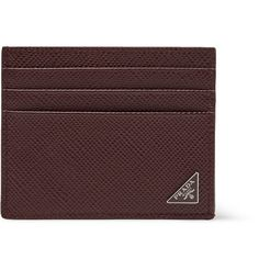 Prada's burgundy holder makes it easy to stay organised. Made in Italy from pebble-grain leather, this compact piece easily fits six cards and has a central pocket for cash and receipts.