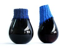 Innesti is a series of vessels by Alexandra Denton and Sofia Lazzeri that combine glass and textiles.