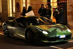 Taking a beautiful and highly pricy car and painting it with camoflauge.... Disgusting and beautiful.  camoflauge ferrari 458 italia