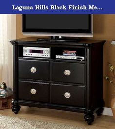 Laguna Hills Black Finish Media Chest. Clean-cut silhouettes and a sleek black finish gives this Laguna Hills Black Finish Media Chest a touch of cool elegance and luxurious appeal. Four generously sized drawers and two open compartments, complete with nail-head designed pulls, give this piece and give this piece style and functionality and is perfect for storing and displaying your home entertainment.