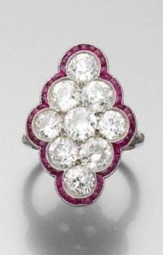 AN ART DECO, DIAMOND, RUBY AND PLATINUM RING, CIRCA 1920.