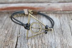 the Harry potter Deathly Hallows Bracelet jewelry by hannahome, $1.40