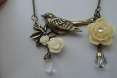 'Lovely White Rose with Bird Necklace' is going up for auction at  5pm Mon, Oct 1 with a starting bid of $11.