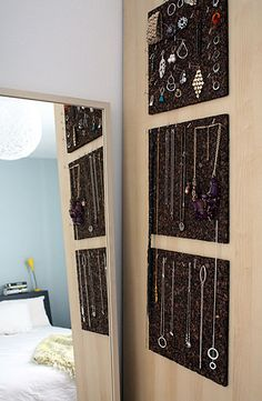 "DIY -- ""cork tiles and t-pins from an office supply store"" -- love the dark cork board... After all my research, I think I'll go with this idea!  But might use furniture tacks like in this post: http://www.hellobeautyblog.com/2010/05/easy-elegant-diy-jewelry-storage-display/."