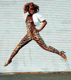 Santigold jumping in heels