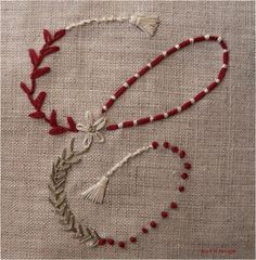 Liking the couching stitches with contrasting thread and the stitched tassels
