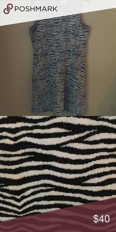 Michael KORS dress This tank top zebra print dress is perfect for a day at the office in the summer. Paired with some black pumps you'll have everyone wondering where you got it! MICHAEL Michael Kors Dresses Midi