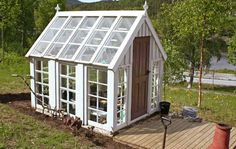old windows greenhouse | Charming greenhouse from old windows