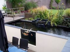 Water gardens and Koi ponds can be designed to fit your lifestyle. Koi provide endless hours of entertainment - see our 34 Koi pond design ideas below. Koi Fish Pond, Fish Ponds, Large Backyard, Ponds Backyard, Backyard Ideas, Garden Ideas, Modern Pond, Koi Pond Design, Building A Pond