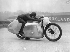 11th March 1938: Eric Fernihough on his new streamlined Brough Superior motorcycle, at Brooklands, where he hopes to regain the world speed record