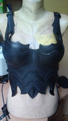 Light brown deerskin leather bra D cup with brass rings in front center and at sides for crisscross ties.