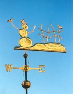 SNOWMAN WEATHER VANE Frosty the Snowman Weathervane by West Coast Weather Vanes.  This Snowman weather vane was made in a combination of copper and brass, we can also add optional gold leaf to mimic the white snow. This adding to the winder wonderland common at Christmas time.