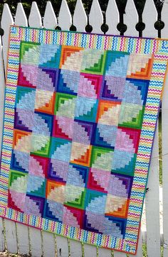 Wiggly Worms log cabin quilt pattern by Cut Loose Press, seen at Checker Newsletter | Creative Grid ruler