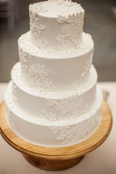 a lace cake by http://weddingcakesbyjimsmeal.com/ almost as gorgeous as the Bride's lace gown  Photography by julietelizabeth.com