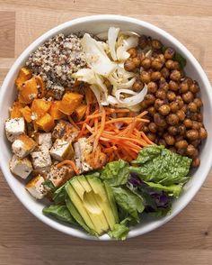 Protein-packed Buddha Bowl    quinoa, greens, sweet potato, onions, chickpeas, tofu, carrots, avocado