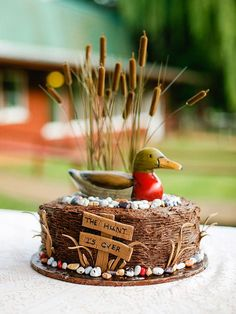 Decorate the groom's wedding cake with a rustic decoy decoration for an iced hunting-themed finish.