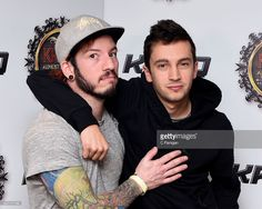 Musicians Josh Dun (L) and Tyler Joseph of Twenty One Pilots pose backstage during 106.7 KROQ Almost Acoustic Christmas 2015 at The Forum on December 12, 2015 in Los Angeles, California.